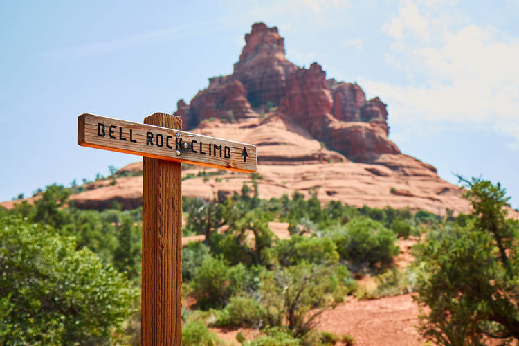Arizona Bell Mountain Desert Sign Beauty In Nature Close-up Day Focus On Foreground Guidance Mountain Nature No People Outdoors Road Sign Rock - Object Scenics Signboard Sky Trail Tranquility