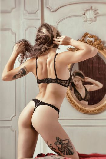 Rear View Of Woman In Lingerie At Home