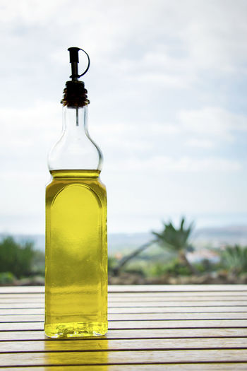 Close-up of olive oil on table
