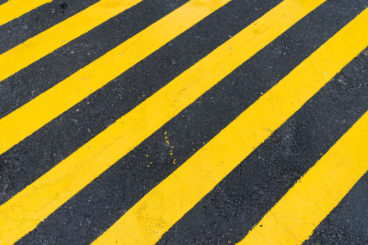 Close-Up Of Yellow Zebra Crossing