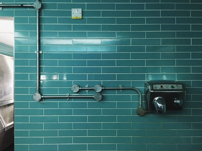 Turquoise Tiles Bathroom Wall Shiny Toilet Design Interior Interior Design Hand Dryer Electric Appliance Silver  Shiny Things Personal Hygiene Hygiene Hand Washing