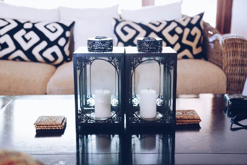 Close-up of lanterns on table at home