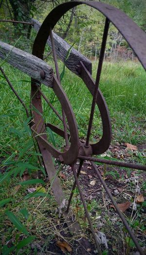 Farm Equipment Green Color Outdoors Grass Nature Close-up Country Wood Metal wheel