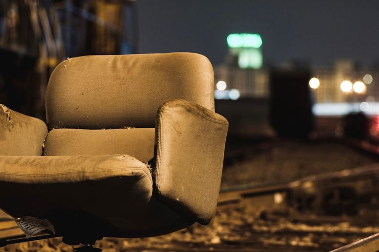 Close Up Of Abandoned Chair Outdoors At Night