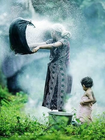 mother land watership child hood memories.. Adults Only One Woman Only One Person Outdoors Adult Walking Around Enjoying Life 43 Golden Moments Taking Photos Happiness Hello World One Man Only Handsome Friendship Looking At Camera Young Adult Indoors  Indoors  Fb Indoors Women Only Women People Nature Day