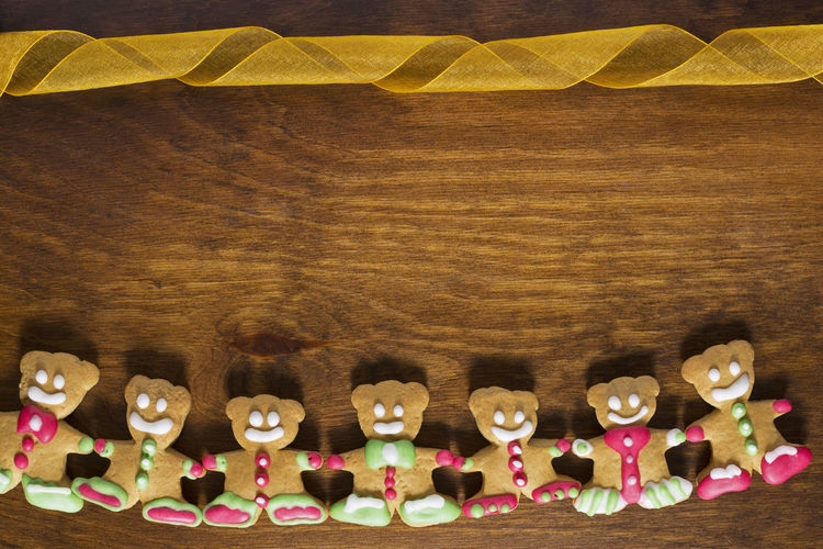 Gingerbread Teddy Bear Arranged On Borders Of Wooden Table