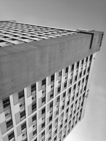EyeEmNewHere Blackandwhite Streetphotography Minimalism Architecture Building Exterior Built Structure Window Low Angle View Day Outdoors No People Clear Sky Sky City Rethink Things The Graphic City Visual Creativity