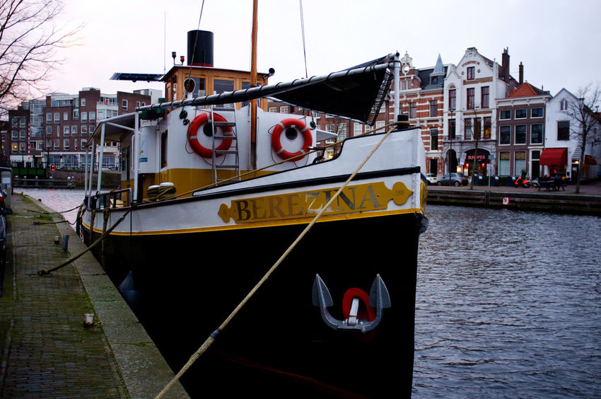 Colors Haarlem Noord Holland X100 Architecture Boat Building Exterior Built Structure Canal Day Fujifilm_xseries Mode Of Transport Moored Nautical Vessel No People Outdoors Sailing Sky Streetphotography Transportation Water Waterfront