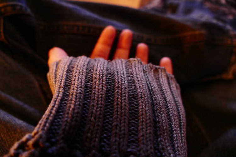 Cropped image of person wearing woolen sweater
