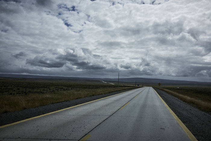 Rural Road and Overcast Sky in Patagonia Chile Road Travel Clouds And Sky Diminishing Perspective Grassland No People Overcast Sky Patagonia Rural Scene Rurual Scene South America Tranquil Scene vanishing point Vehicle Shot