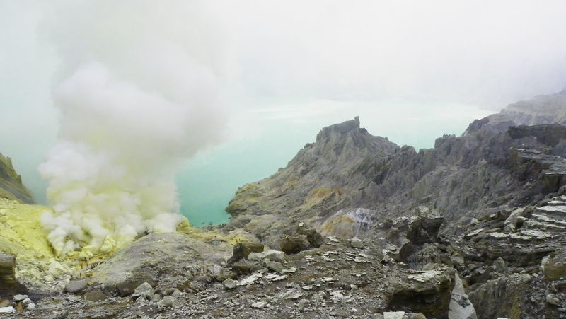 Smoking crater, Kawah Ijen, Indonesia. The smoke is mainly composed of toxic gases such as sulfur dioxide and hydrogen sulfide. Acid Acid Lake Beauty In Nature Crater Crater Lake Day Gas Geology Kawah Ijen Lake Landscape Mountain Natural Phenomenon Nature Nature No People Other Worlds Outdoors Physical Geography Scenics Smoke - Physical Structure Sulphur Toxic Volcanic Landscape Volcano