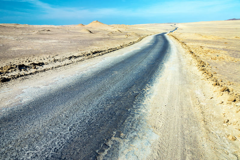 Dirt road passing through a dry barren desert in Paracas, Peru America Bare Countryside Desert Dirt Dry Dust Famous Landmark Landscape National Park Nature Nature Outdoors Paracas Peru Pothole Road Rocks Sand Scenery Scenics South America View Wild