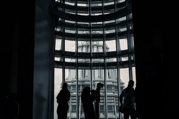 People standing in petronas towers