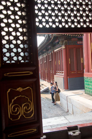 "Inside ""Lama temple"", Yonghegong, Beijing, China ASIA Beijing Lama Temple Spirituality Tradition Travel Architectural Column Architecture Buddhism Building Exterior Built Structure Day Full Length Indoors  Landmark One Person People People And Places Real People Religion Spiritual Temple Walking Window Women"