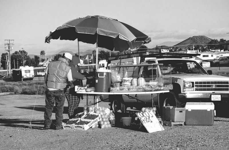 roadside fruit vendor The Photojournalist - 2016 EyeEm Awards Streetphotography Eyeemgallery Eyeemphotography Ilovephotography Eye4photography  EyeEm Gallery What I See Mobile Photography Looking For Inspiration Street Vendor Fruit Stand Bnw_captures Bnw_life Black And White Photography EyeEmbnw Real People Real Life Taking Photos The Great Outdoors - 2016 EyeEm Awards My Photography Edited By Me
