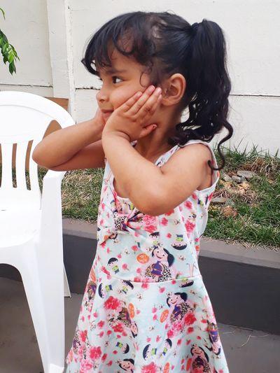 Cute girl standing in yard