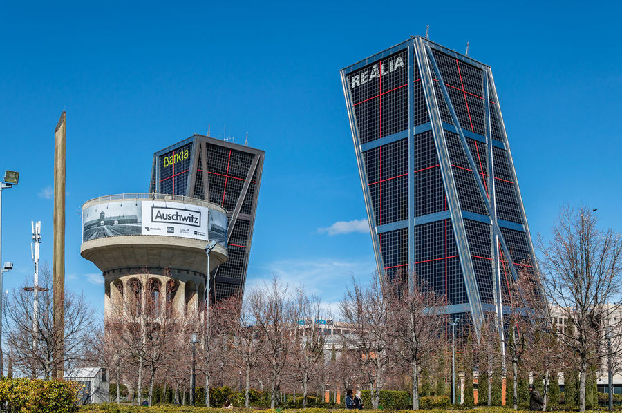 Leaning towers office building in Madrid against blue sky Business Financial District  Kio Madrid Modern Architecture SPAIN Architecture Bare Tree Blue Sky Building Exterior Built Structure City Clear Sky Day Downtown District Growth Landmark Leaning Leaning Tower Low Angle View Nature No People Office Building Office Building Exterior Outdoors Sky Skyscraper Tower Tree