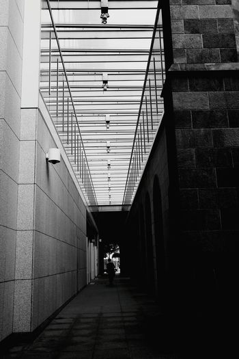 Architecture The Way Forward Day One Person Architecture Black And White Collection  Black And White Collection  Blackandwhitephoto City Blackandwhite Blackandwhitephotos Silhouette Monochrome World Low Angle View Blackandwhiteonly Cityscape Blackandwhite Photography City Street