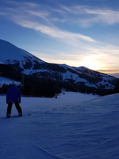 Palandoken mountain, Erzurum, Turkey Snowboarding Adventure Beauty In Nature Cold Temperature Full Length Landscape Leisure Activity Lifestyles Men Mountain Mountain Range Nature One Person Outdoors Real People Rear View Scenics Ski Holiday Skiing Sky Snow Snowboard Snowcapped Mountain Sunrise Tranquil Scene Vacations Weather Winter