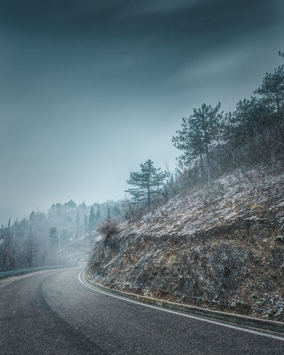 Monti Lessini Beauty In Nature Cold Temperature Day Fog Landscape Mist Mountain Nature No People Outdoors Road Scenics Sky Snow Street The Way Forward Tranquil Scene Tranquility Transportation Tree Weather White Line Winding Road Winter