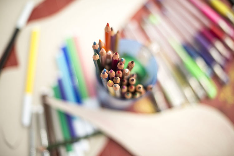 High Angle View Of Colored Pencils In Desk Organizer On Table