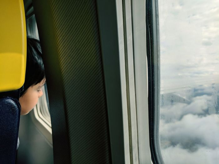 Dream Airplane Flight Fly Kid Dreaming Sky Low Section Looking Through Window Window Women Close-up Sky Cloud - Sky Aeroplane The Traveler - 2018 EyeEm Awards It's About The Journey