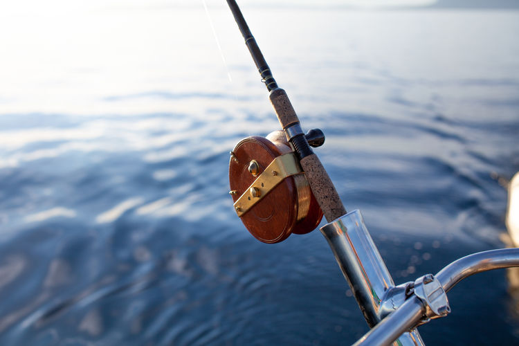 Close-up of fishing rod hanging on rope