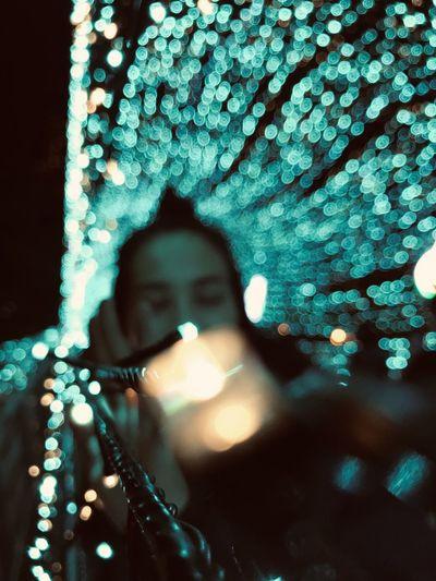 Portrait of woman against illuminated tree