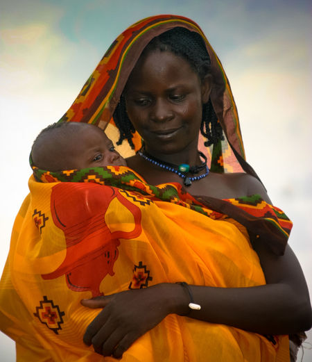African madonna Portrait Of A Woman Woman And Baby Baby Bonding Happiness Holding Protrait Real People Togetherness Young Women