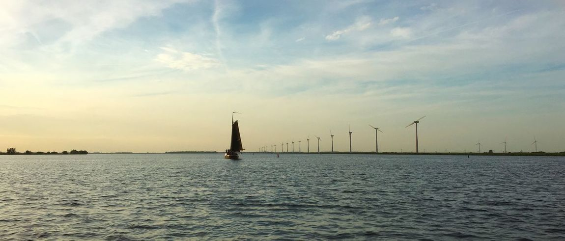 Botter at the Eemlake Beauty In Nature Cloud - Sky Fuel And Power Generation Nature No People Outdoors Renewable Energy Sailboat Scenics - Nature Sky Sunset Tranquil Scene Tranquility Travel Turbine Water Waterfront Wind Turbine