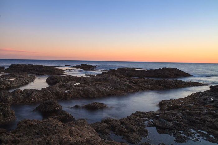 Long exposure of sunset over rocks, giving a mist like effect over ocean in Laguna Beach, California, United States Beach Beauty In Nature Coastal Coastline Day Horizon Over Water Laguna Beach Landscape Nature No People Outdoors Rocks Scenics Sea Seaweed Sky Sunset Sunsets Water Flow