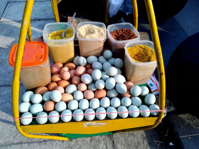 High Angle View Of Eggs And Ingredients For Sale At Market Stall