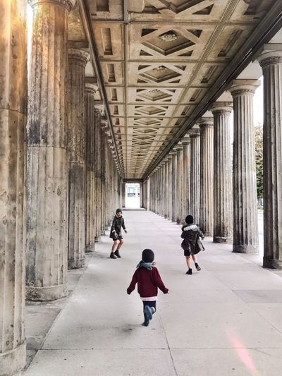 Architecture Childhood Kids Being Kids Running Chase Children Sibblings Built Structure Real People Outdoors Berlin Togetherness Playing Child Fun Architectural Column The Way Forward Perspectives And Dimensions Perspective People Sun Sunlight