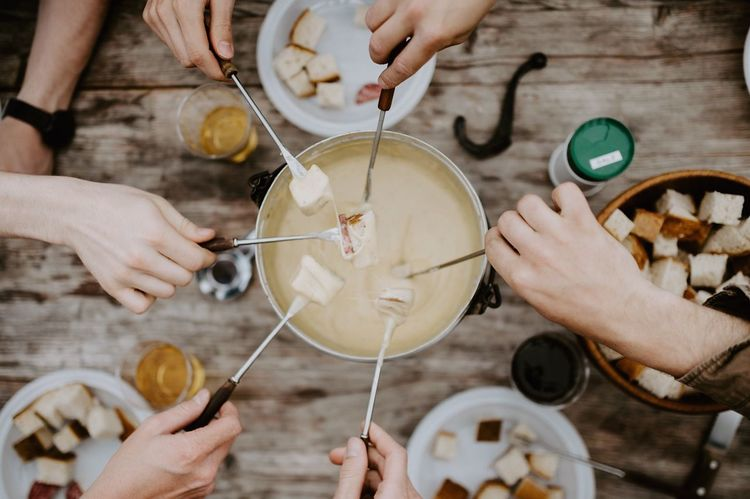 """You don't have to say """"cheese"""", everybody smiles when they eat fondue. Cheese Switzerland Swiss Fondue Human Hand Hand Human Body Part Group Of People Food And Drink Friendship Lifestyles Switzerland Swiss Fondue Human Hand Hand Human Body Part Group Of People Food And Drink Friendship Lifestyles"""