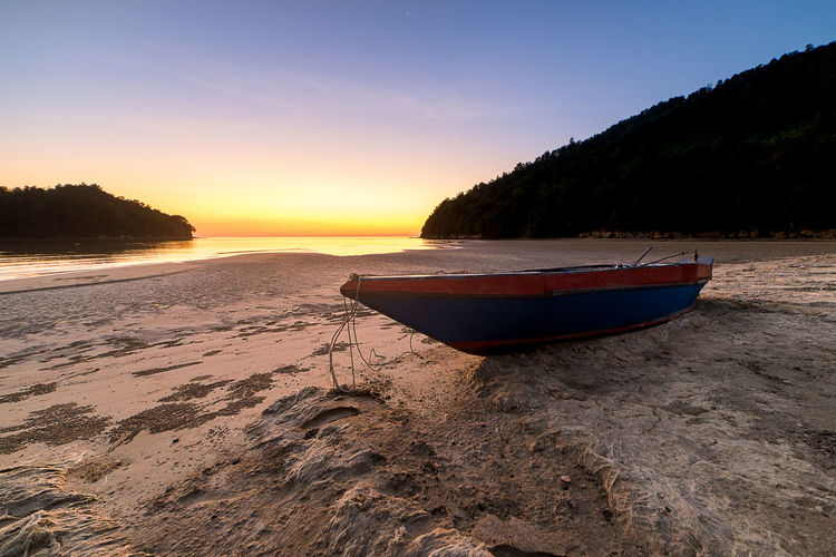 Nature Background_sunset Sky Nautical Vessel Water Beach Land Scenics - Nature Tranquility Beauty In Nature Sunset Sand Tranquil Scene Sea Transportation Nature Tree Moored Mode Of Transportation No People Plant Outdoors Rowboat