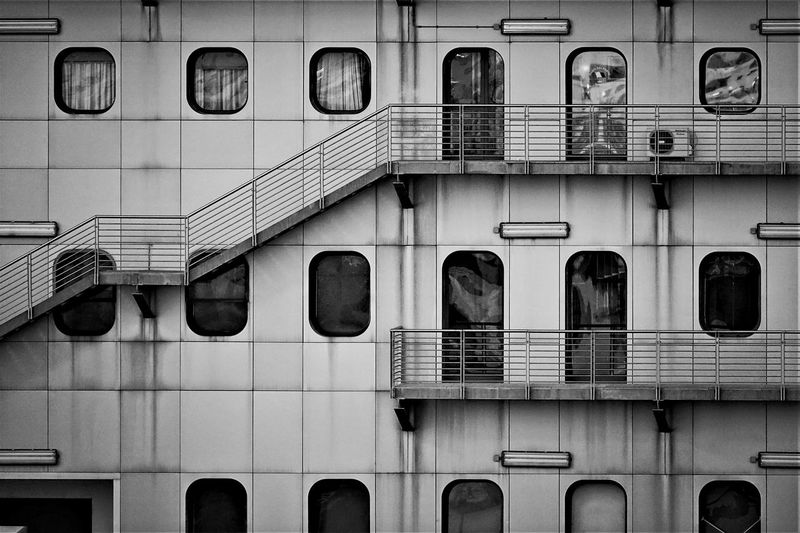 Low angle view of handrails and windows on boat