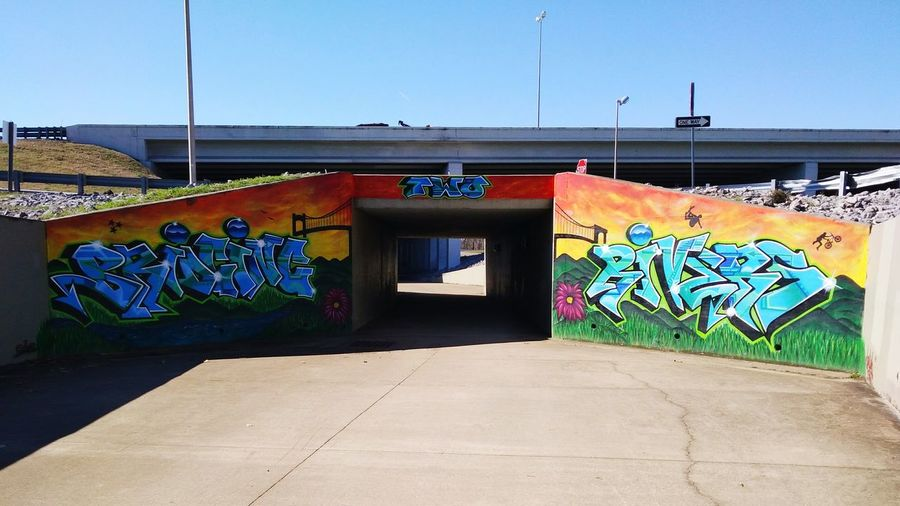 Spray Paint Mural Tunnel Rocks Cracks Shadows Path Urban Art Urban Street Photography Tennessee Beautiful Day GreenwayTrailHead Bridges Trails Photography Art Park Graffiti Street Art No People Colour Your Horizn
