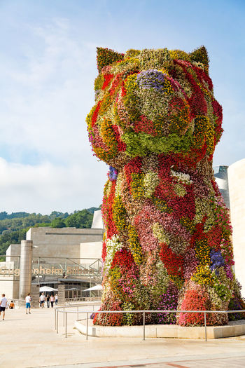 The floral sculpture 'Puppy' designed by Jeff Koons - Standing in front of Bilbao's Guggenheim Museum Adult Adults Only Architecture Art Contemporary Art Day Flower Giant Guggenheim Guggenheim Bilbao Jeff Koons Men Museum Nature Only Men Outdoors People Puppy Sculpture SPAIN Statue Tourism Travel Travel Destinations