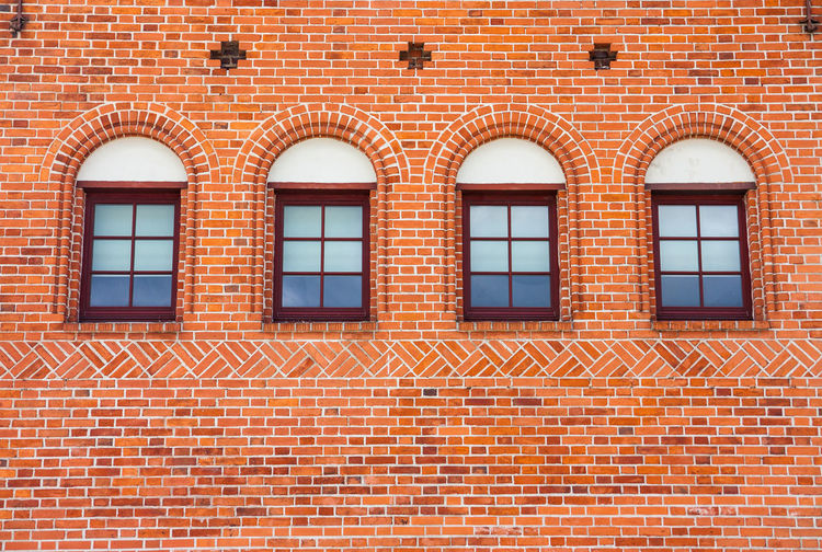Full frame shot of brick wall with windows