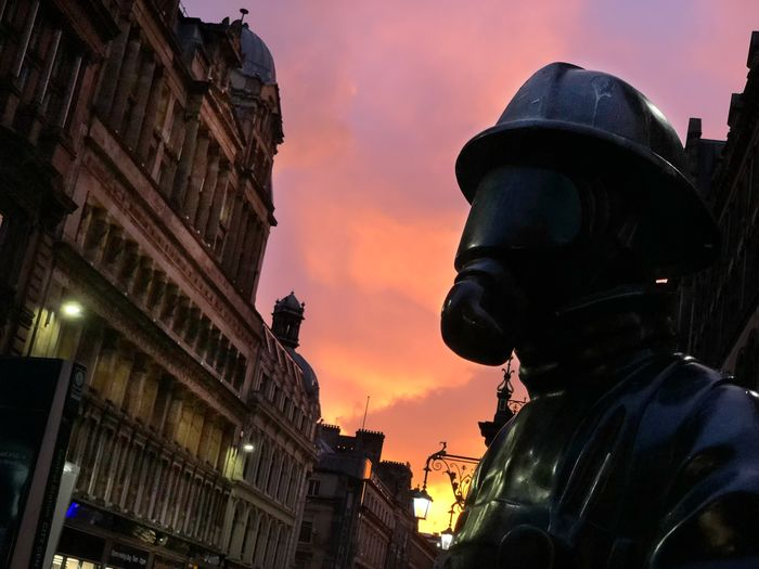 'Citizen Firefighter' sculpture by Kenny Hunter outside Glasgow Central Station at sunrise. Greek Thomson Alexander Greek Thomson Alexander Thomson Kenny Hunter Firefighter Sculpture Dawn Glasgow  Scotland Red Sky Sunrise Architecture City