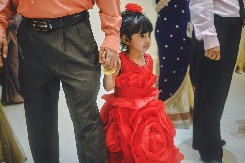 Flower Girl . This small kid was both scared and irritated of the wedding crowd. So she was holding her father's hand tight. Wedding Red Dolled Up♥ Moments Realcandid Snap a Stranger Enjoy The New Normal Chittagong Bangladesh Uniqueness