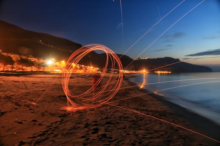 Sparks Of Circular Lights On Beach