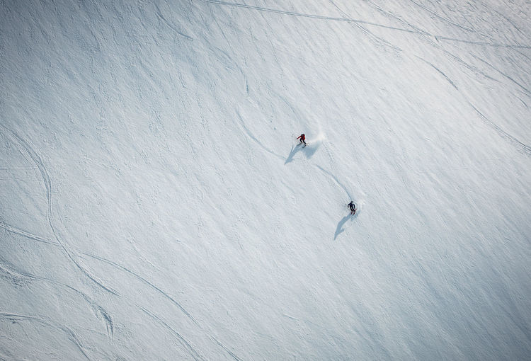 High angle view of people skiing on snowcapped mountain