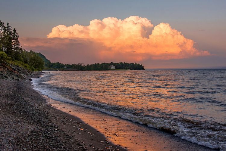 There's a storm brewing on the North Shore! Sea Sky Scenics Beauty In Nature Tranquility Beach Nature Sunset Water Cloud - Sky Tranquil Scene No People Outdoors Sand Horizon Over Water Tree Day Malephotographerofthemonth Streamzoofamily Beauty In Nature Storm Cloud