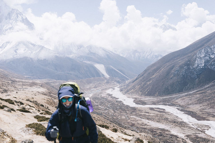Full length of person on snowcapped mountains against sky
