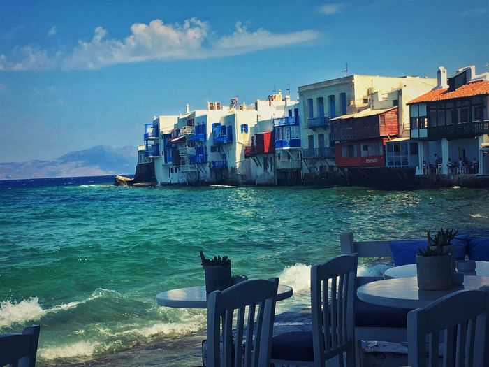 Mykonos,Greece Architecture Blue Building Building Exterior Built Structure Chair City Cloud - Sky Day Nature No People Outdoors Residential District Sea Seat Sky Table Water Waterfront