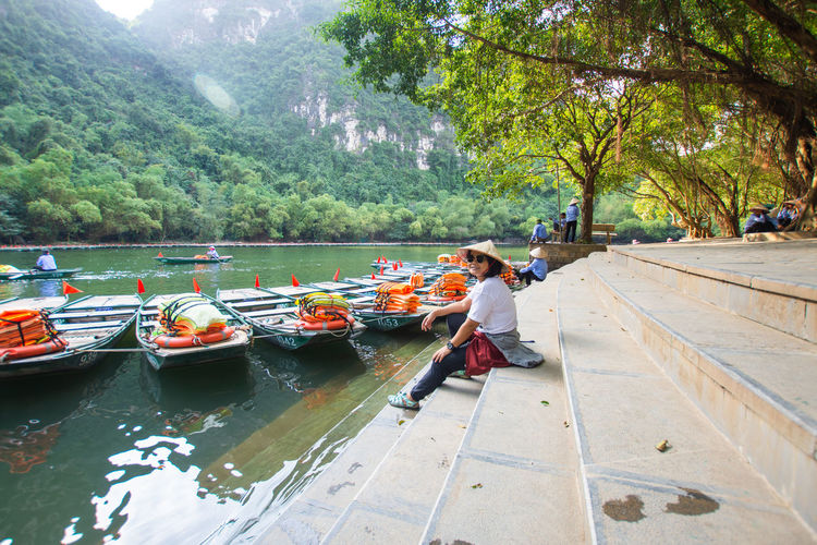 travel at Trang An, Ninh Binh, Vietnam Tree Real People Full Length One Person Plant Day Water Nature Lifestyles Child Men Mountain Adult Childhood Women Casual Clothing Nautical Vessel Transportation Outdoors