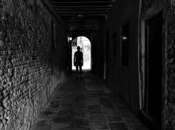 Adult Arcades Architecture Blackandwhite Photography Built Structure Day Full Length Indoors  Lifestyles Men One Person People Real People Rear View Streetphotography The Way Forward Tunnel Urban Landscape Walking