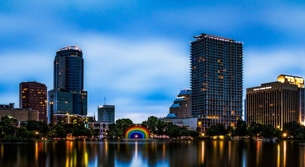 Orlando Strong. Photo of the bandshell which was painted rainbow colors after the Pulse Terror attack in Orlando Florida. Long Exposure Night Photography Long Exposure Shot Long Exposure Cityscape Nature Illuminated Tree Growth Low Angle View No People Blue Outdoors Waterfront Sky Reflection Skyscraper Building Exterior Built Structure Modern Water Architecture Orlando Orlando Florida Lake Eola Park Lake Eola Downtown Orlando  Florida Central Florida City Downtown