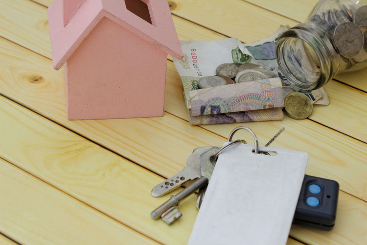 Savings for a house concept Wooden Background Toy House Money Jar House Keys First House Concept Conceptual Home Improvement Wood - Material Hardwood Floor Table Home Ownership Close-up Renovation
